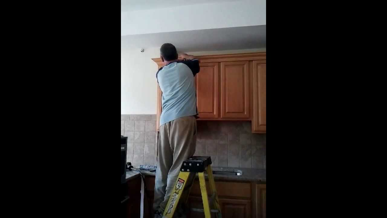 how to repair kitchen cabinets youtube refinishing kitchen cabinets contractor contractor grade kitchen cabinets