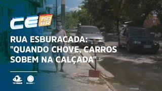 """RUA ESBURACADA: """"Quando chove, carros sobem na calçada"""", diz moradora"""