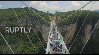 China: World's longest glass-bottom bridge opens in Hunan province