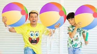 Jason plays with big lollipop for kids