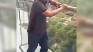 You don't get more scared than these tourists stepping on cliffside glass walkways