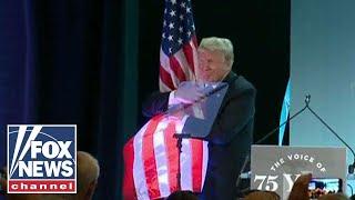 Video of Trump hugging American flag goes viral