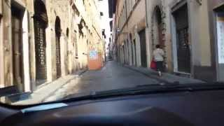 Driving through the old centre of Florence in Italy