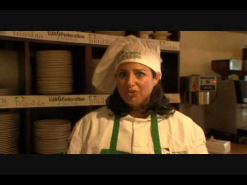 Susie Fishbein at Masbia soup kitchen inviting you to