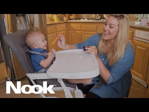 Brand new and redesigned, the Nook has all the great features of the original with the addition of a new functionality. The tray not only swings open, it has four adjustable depths to ensure food stays on the tray and not on your child's lap.
