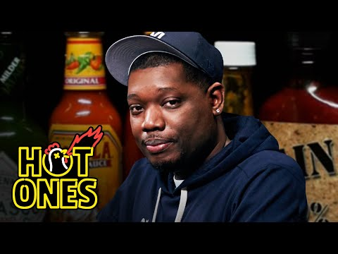 Michael Che Gs Up While Eating Spicy Wings   Hot Ones