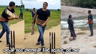 Dil Raju playing cricket with some kids- Kuntala waterfall..
