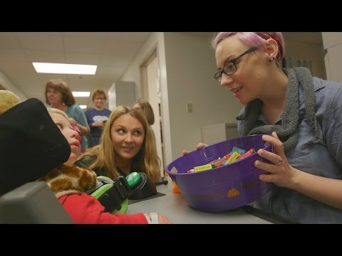 Patients with disabilities at Cincinnati Children's go trick-or-treating at the hospital for Halloween fun.