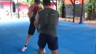Boxing Coach Piotr Leib and Chris Indich on mitts in Tiger Muay Thai / Thailand