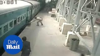 Hero policeman saves woman from slipping under a moving train