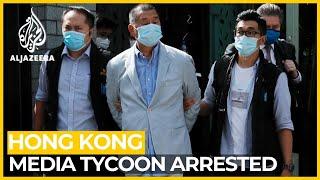 Hong Kong media tycoon arrested, newspaper raided