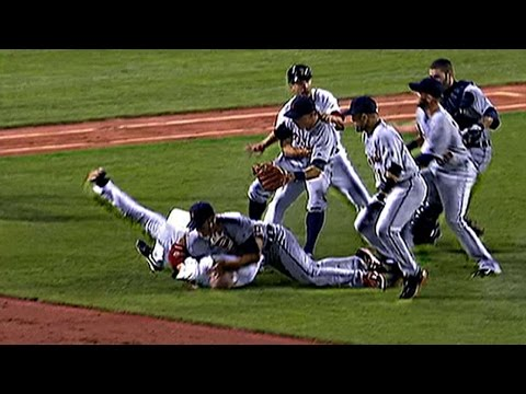 Kevin Youkilis charges the mound after being hit