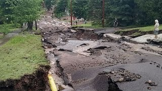 Roads torn up, washed out in 'historic' Mich. flooding