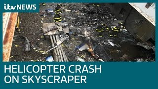 Pilot killed in helicopter crash on Manhattan skyscraper | ITV News