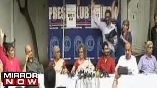 Maoist sympathisers address the media..