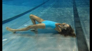 Carla Underwater Swimming alone in the pool.