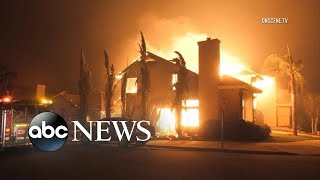 More than 27K evacuated as fire destroys town