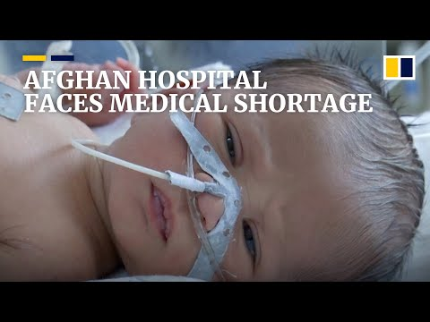 Afghan hospital struggles to handle overflowing patients with dwindling supplies