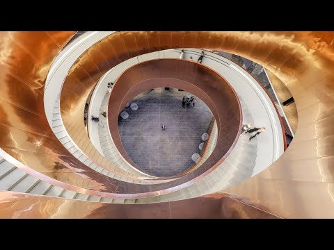 100 metre long helical staircase is clad with 10 tonnes of copper