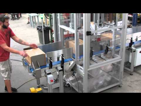 Performance Feeders custom conveyor system transfers packages between a cleanroom and a warehouse
