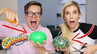 Cutting Open A Wubble Bubble with Orbeez and Slime and Mixing Them Challenge!