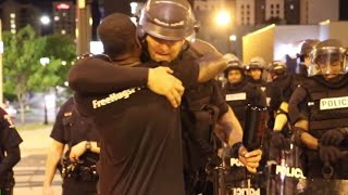 Man gives free hugs to riot police & protesters in Charlotte (RAW)