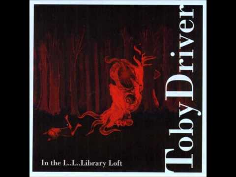 Toby Driver - The Lugubrious Library Loft online metal music video by TOBY DRIVER