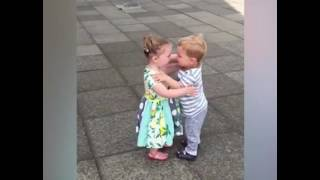 This young couple get the giggles when they kiss!