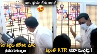 KTR makes fun with kids after opening Basti Dawakhana..