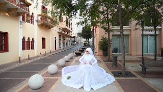 A bride had to run for cover as she was posing for photos in Beirut moments before the explosion