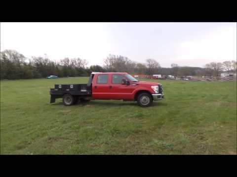 2012 Ford F350 Super Duty XL Crew Cab flatbed pickup truck | no-reserve auction April 26, 2017