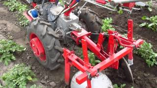 First hilling potatoes after planting tractor.
