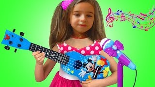 Lana playing Guitar Music Toys and Sing Nursery Rhymes Kid songs on Talent Show
