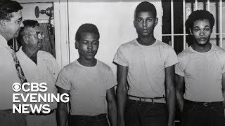 Four black men granted pardons in case seen as example of racial injustice