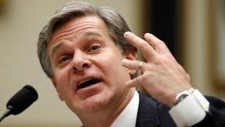 FBI director grilled over Peter Strzok