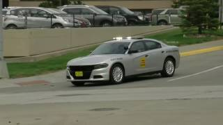 Police motorcade escorts the body of the fallen deputy back to Iowa