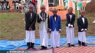 Emikolo n'Embaga:  Nalukwago Olivia ayanjula Mpalanyi.  AAAA