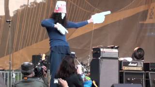 Buckethead playing with nunchucks and doing the robot on stage