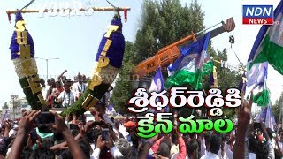 Massive garland bought in crane to felicitate Sridhar Redd..