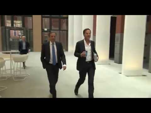 Dutch Prime Minister Mark Rutte cleaning dropped coffee