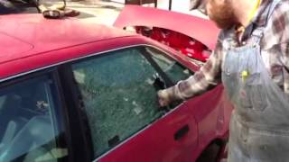 Breaking a car window with a center punch