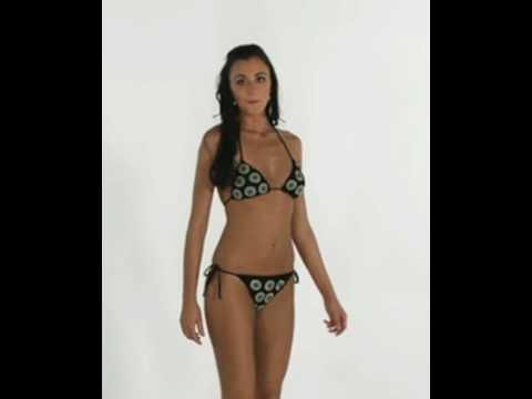 Slim athletic model wears Brazilian bikini Truta
