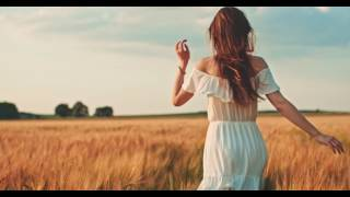 beautiful girl running on sunlit wheat field slow motion 120 fps freedom concept happy woman having