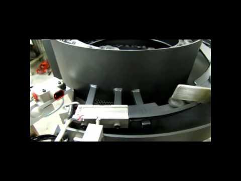 Ultra-compact vibratory bowl orients rubber automotive part