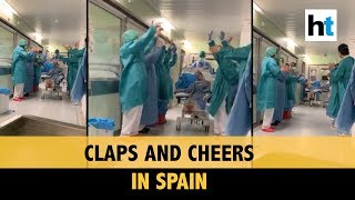 Watch: Nurses in Spain hospital cheer as patient is transf..