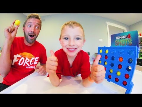 Father & Son PLAY CONNECT FOUR SHOTS! / The Trick Shot Game!