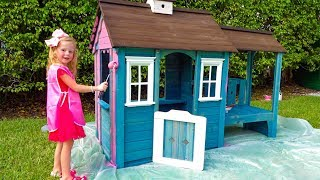 Stacy paints a new playhouses