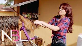 NBL en acción: las chicas lavan y alimentan a los animales de la granja