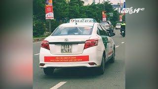 VTC14 | TP HCM yêu cầu taxi Vinasun tháo decal phản đối Uber, Grab