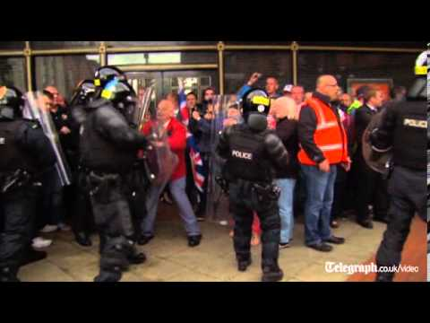 Protesters clash with police in Belfast
